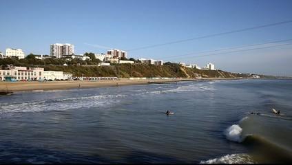 Waves English coast Bournemouth tourist beach surfers