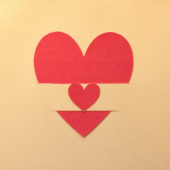 Paper hearts on gold paper background
