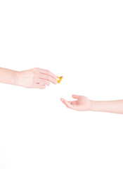 Adult's Hand Giving A Chinese Gold Isolated On White Background
