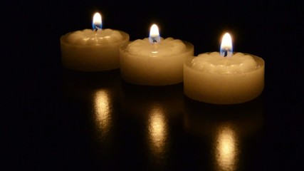 Three tea lights burring