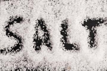 The word salt written into a pile of white granulated salt