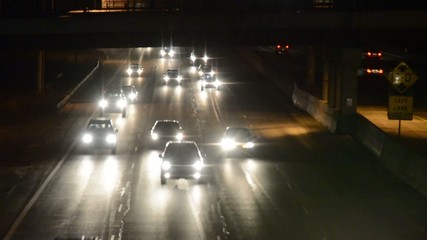 Oncoming headlights of freeway traffic at night
