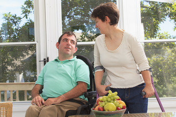 Couple with Cerebral Palsy relaxing on their deck