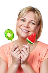 Happy girl with lollipop watermelon and kiwi fruit