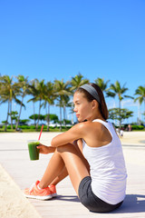 Exercise woman drinking green vegetable smoothie