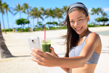 Fitness selfie woman drinking green smoothie