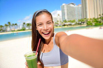 Fitness selfie girl drinking green smoothie