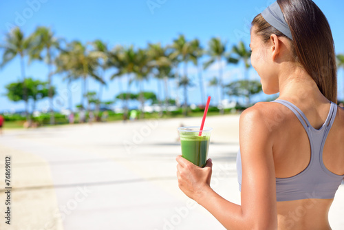 Woman drinking vegetable Green detox smoothie - 76869812