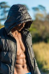 Atheltic African black male wearing black bomber jacket hoodie