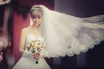 Portrait of a beautiful blonde bride with wedding bouquet