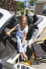 Woman with spinal cord injury lifting her leg entering vehicle