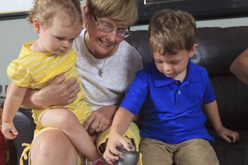 Grandmother with prosthetic leg and her grandchildren