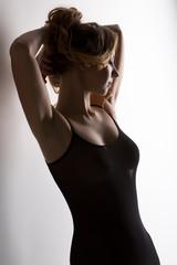 Image of graceful girl dressed in peignoir
