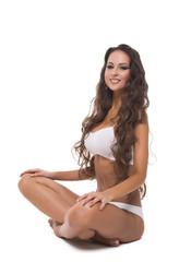 Attractive brunette posing in lotus position