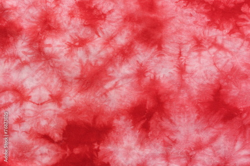 red tie dye fabric background - 76873025