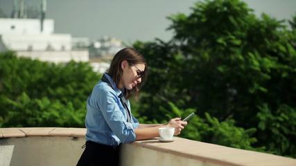 usinesswoman texting, sending sms on smartphone