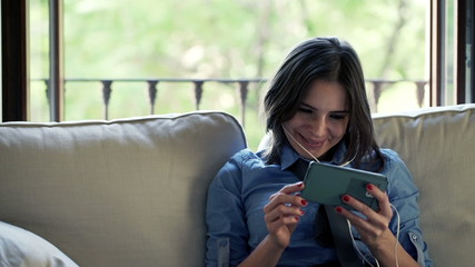 businesswoman watching film on smartphone at home