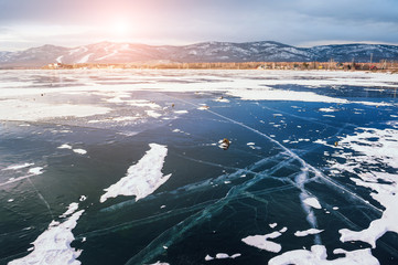 Beautiful ice on the lake at sunset