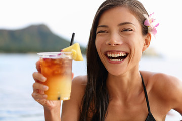 Hawaii woman drinking Mai Tai hawaiian drink
