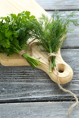 Fresh parsley and dill on a cutting board
