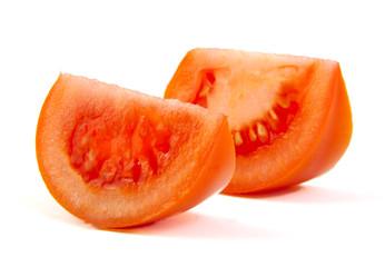 Two slices of tomato on white background.