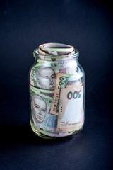 Ukrainian money in the jar