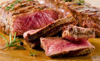 Beef  steak on   cutting board.