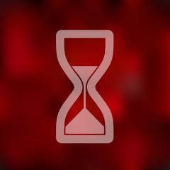 hourglass icon on blurred background