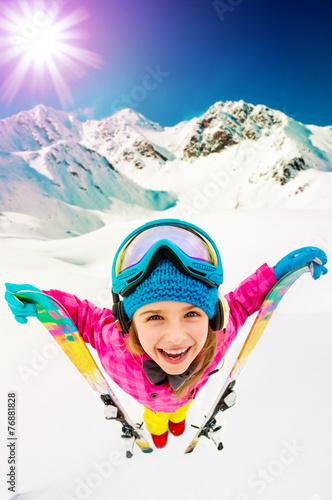 Ski, skier girl enjoying ski vacation, filtered