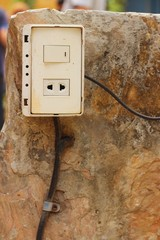 White wall power plug at the park