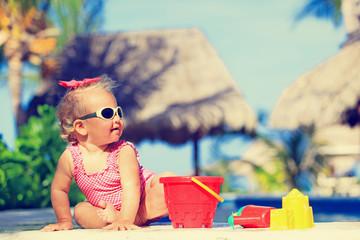 cute toddler girl playing in swimming pool