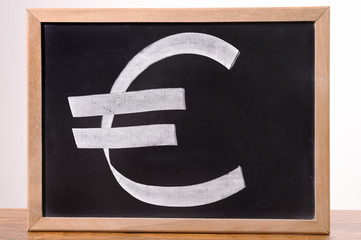 euro currency signs on the blackboard