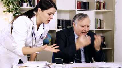 Doctors in medical office fighting and arguing