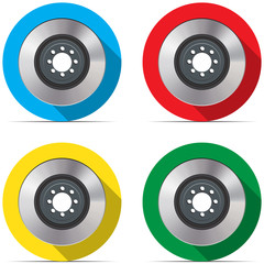 Set with brake discs on colored backgrounds with shadow