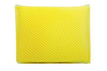 Yellow dishwashing sponge on isolate background