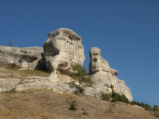 unusual white limestone rock on a background of blue sky