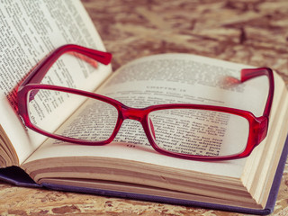 glasses and book with filter effect retro vintage style