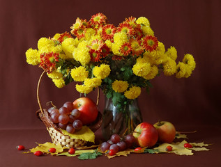 Still life with huge bunch of flowers and fruits