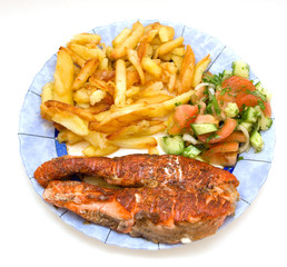 Fried salmon and potatoes with fresh vegetable salade