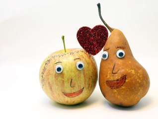 fruits couple in love apple and pear and big red heart
