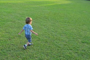Boy running on a grass