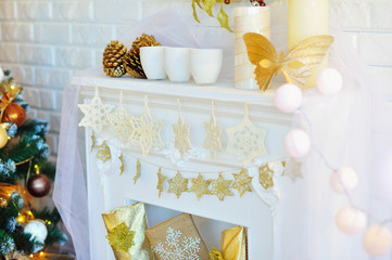 Christmas interior decoration of the fireplace