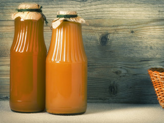 Two glass bottles with juice