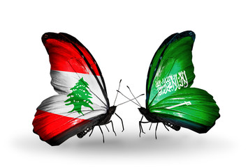 Two butterflies with flags Lebanon and Saudi Arabia