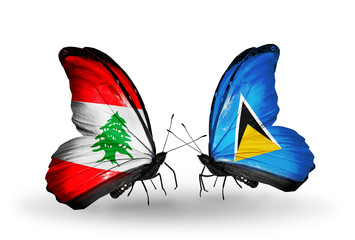 Two butterflies with flags Lebanon and Saint Lucia