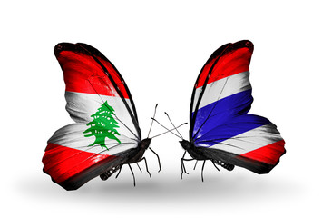 Two butterflies with flags Lebanon and Thailand