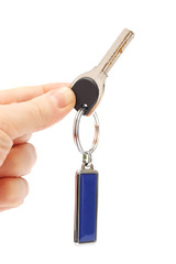 key with a keychain in the hand