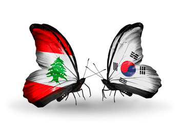 Two butterflies with flags Lebanon and South Korea