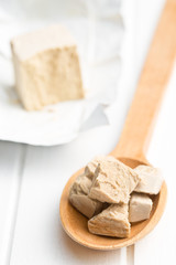 fresh yeast on wooden spoon