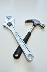 A wrench and a hammer.